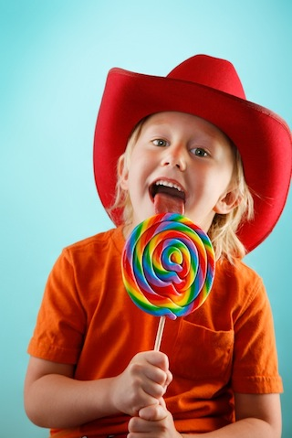 Kid with Colored Lollipop