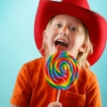 boy eating a colored lollipop
